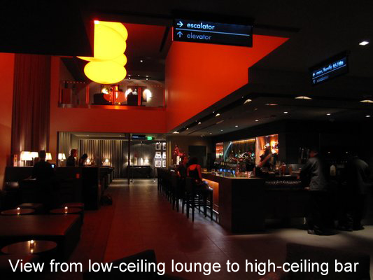 view from low ceiling ipic lounge to high ceiling ipic sports bar